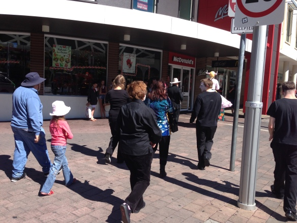 The walking tour continues past McMuck and The Bus Interchange, led by the antler girl on stilts