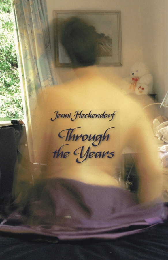 A book cover of Jenni Heckendorf's memoir Through the Years, a self portrait, her back with the title on it and the image is blurred slightly to depict her movements, a tasteful and sensuous image.